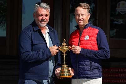 Team captains Darren Clarke and Davis Love III pose with the Ryder Cup Trophy prior to the 2016 Ryder Cup at Hazeltine National
