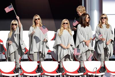 Justine Reed, Nichole Moore, Amy Mickelson, Sybi Kuchar and Becky Edwards wave flags during the 2016 Ryder Cup Opening Ceremony at Hazeltine
