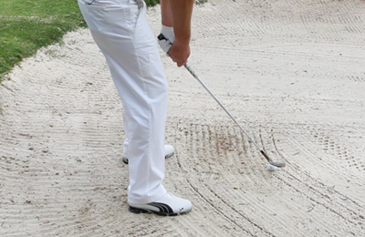 Learn to hit a high, soft landing bunker shot